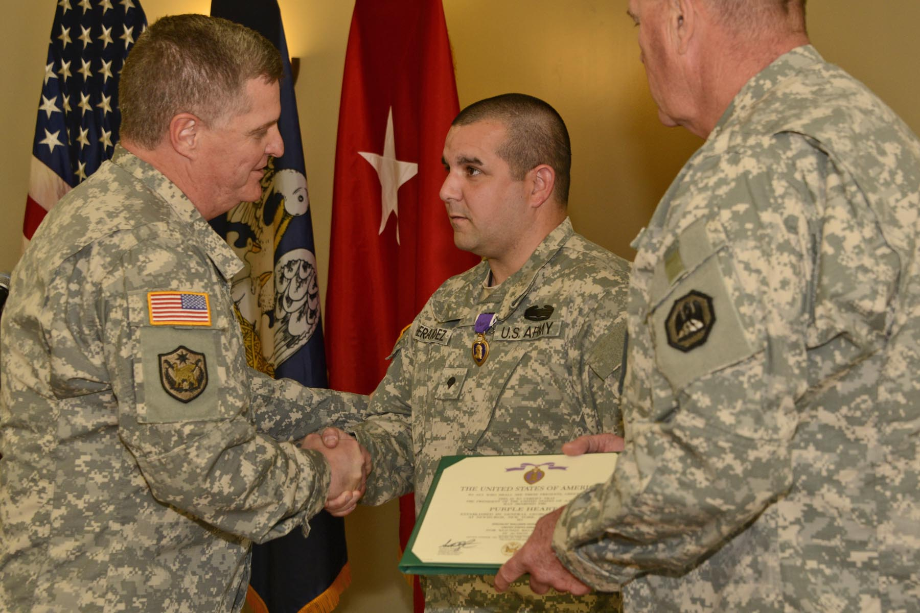 Guardsmen receive the Purple Heart during official ceremony