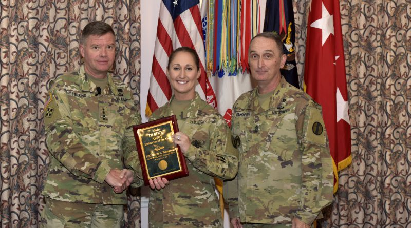 Staff Sgt. Nicole Bourgeois, 2016 TRADOC National Guard Instructor of the Year, 1st Battalion (Noncommissioned Officer Academy), 199th Regiment Regional Training Institute at Camp Cook in Ball, Louisiana, receives a plaque and congratulations from Gen. David Perkins, commanding general of U.S. Army Training and Doctrine Command, and Command Sgt. Maj. David Davenport, TRADOC senior enlisted leader, during the 2016 TRADOC Instructor of the Year ceremony at the Fort Eustis Club in Virginia, Aug. 3, 2017. (U.S. Army photo by Angel Clemons)