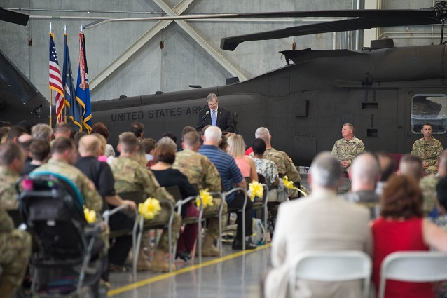 Louisiana State Senator John Kennedy addresses Soldiers of the 1st Assault Helicopter Battalion, 244th Aviation Regiment, and their families during a deployment ceremony at the Army Aviation Support Facility #1 in Hammond, Louisiana, Oct. 6, 2017. The Hammond-based unit deployed to Kuwait and other locations in the region to provide aerial medical evacuation and equipment and personnel transport in support of Operations Spartan Shield and Inherent Resolve. (U.S. Army National Guard photo by Staff Sgt. Josiah Pugh)