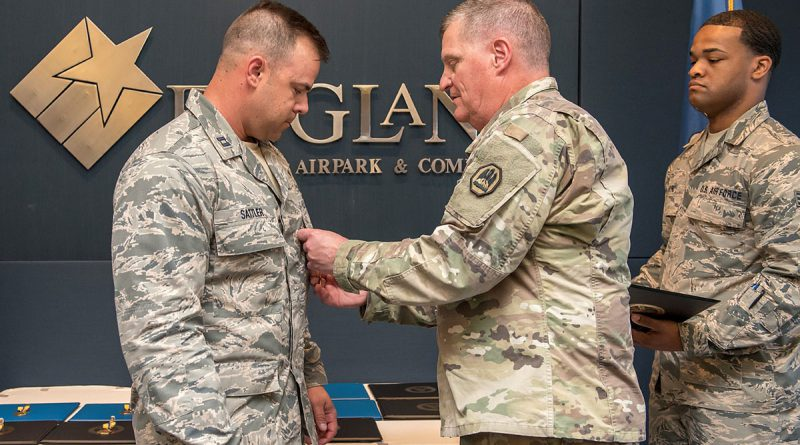 Maj. Gen. Glenn H. Curtis, adjutant general of the Louisiana National Guard, awards Capt. Alex Sattler, 259th Air Traffic Control Squadron, Louisiana Air National Guard, the Bronze Star Medal during the 259th award ceremony at the England Air Park Terminal in Alexandria, Louisiana, April 15, 2018. Sattler was one of 16 Airmen from the LAANG honored for their deployment to Iraq in support of Operation Inherent Resolve. (U.S. Air National Guard photo by Senior Airman Cindy Au)