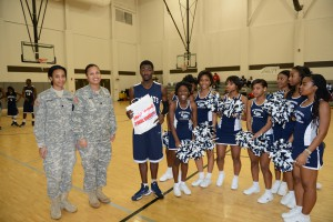NEW ORLEANS - Louisiana National Guardsmen Spc. Cidney McFarland and Capt. Yvonne Davis honor KIPP Renaissance High School basketball player Nick Palmer and the Student Athlete of the Week at a game between KIPP and Edna Karr High School at Lake Area High School, in New Orleans, Jan. 31. The LANG recognizes these students for their work ethic, leadership qualities, and dedication both on the court and in the classroom. (National Guard photo by Capt. Lance T. Cagnolatti, Louisiana National Guard Public Affairs Office/RELEASED)
