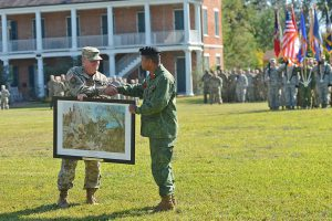 "Maj. Gen. Glenn H. Curtis, adjutant general of the Louisiana National Guard presents Brig. Gen. David Jones, commander of the Belize Defence Force, with a commemorative print to celebrate the 20th anniversary of the Stare Partnership Program between Louisiana and Belize on Nov. 4, 2016, at Jackson Barracks, New Orleans, La. The print highlights just a few of the many training opportunities conducted over the past 20 years – ""Shoulder to Shoulder Together We Protect What Matters."" (U.S. Air National Guard photo by MSgt Toby M. Valadie)"