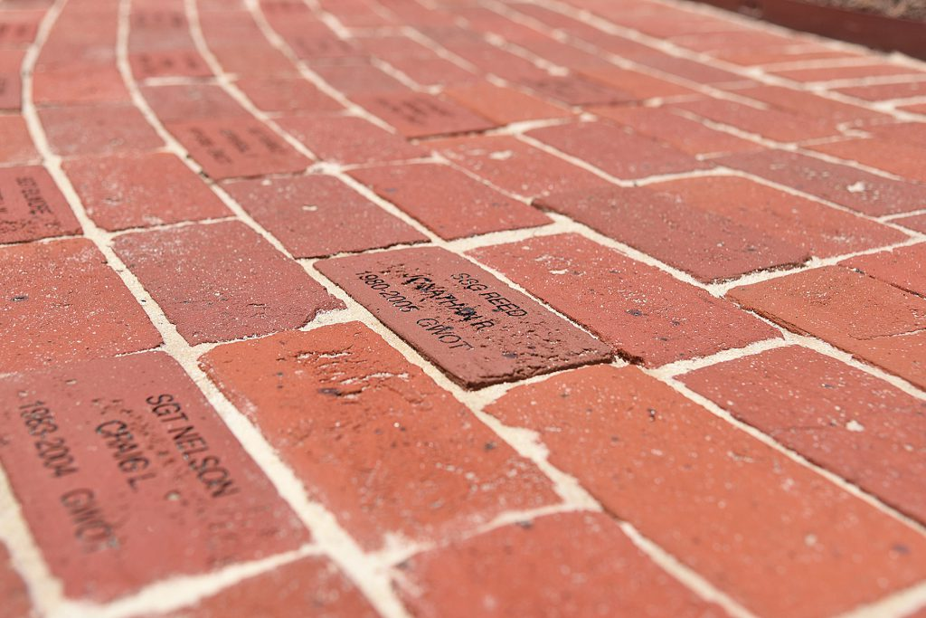 Bricks memorializing fallen Louisiana National Guardsmen at the base of a new monument at Louisiana Veterans Memorial Park in Baton Rouge, Louisiana, May 21, 2019. (U.S. Army National Guard photo by Staff Sgt. Garrett L. Dipuma)