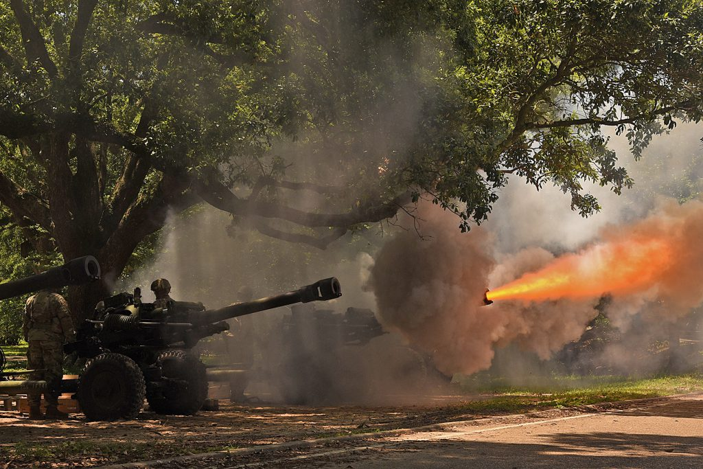 The Louisiana National Guard's 1st Battalion, 141st Field Artillery Regiment fires a Howitzer as part of a 19 cannon salute for Gov. John Bel Edwards at a ceremony dedicating a monument memorializing fallen Louisiana Guardsmen at Louisiana Veterans Memorial Park in Baton Rouge, Louisiana, May 21, 2019. (U.S. Army National Guard photo by Staff Sgt. Garrett L. Dipuma)