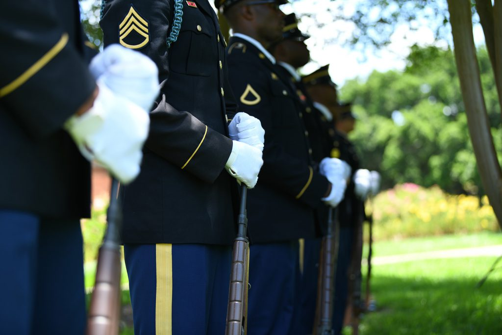 Soldiers in the Louisiana National Guard Military Funeral Honors Program stand ready to render a firing party salute during an official ceremony memorializing a new monument honoring fallen Louisiana Guardsmen at Louisiana Veterans Memorial Park in Baton Rouge, Louisiana, May 21, 2019. (U.S. Army National Guard photo by Staff Sgt. Garrett L. Dipuma)